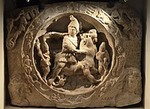 220px-White_marble_relief_with_Mithras_bull-slaying_scene_(CIMRM_810-811),_from_Walbrook_Mithraeum_in_Londinium,,_AD_180-220,_Museum_of_London_(14007820699)
